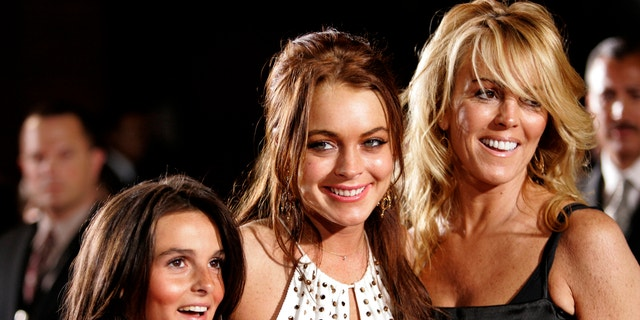 """Lindsay Lohan poses with her mother Dina and sister Aliana at the premiere of """"Just My Luck"""" in Los Angeles in 2006."""