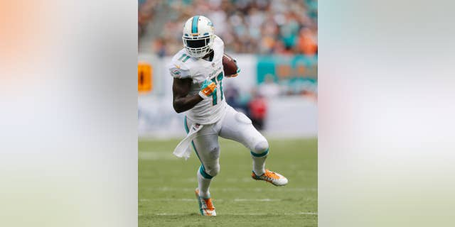 FILE - In this Sunday Sept. 7, 2014 file photo, Miami Dolphins wide receiver Mike Wallace (11) runs for a touchdown during the second half of an NFL football game against the New England Patriots, in Miami Gardens, Fla. Mike Wallace is still stewing about the Miami Dolphins' latest sputtering offensive performance. Wallace said Tuesday, Oct. 28, 2014 he can't identify the problem, but added progress needs to come quickly because the Dolphins face several high-scoring teams in the next month, starting with San Diego on Sunday.  (AP Photo/Wilfredo Lee, File)