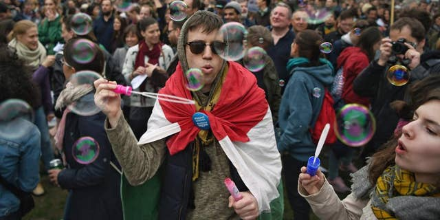 People gather in Budapest, Hungary, Saturday, April 15, 2017, to oppose government policies that are seen as limiting academic freedom and intimidating civic groups that receive foreign funding. (Zoltan Balogh/MTI via AP)