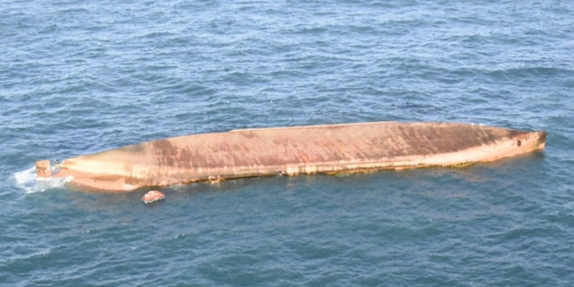 A cargo ship is floating upside down in the English Channel after colliding with a fishing vessel Tuesday.