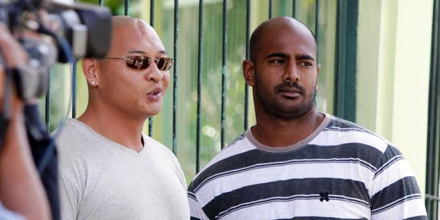 FILE - In this Aug. 17, 2011 file photo, Australian death-row prisoners Myuran Sukumaran, right and Andrew Chan, left, stand in front of their cell during an Indonesian Independence Day celebration at Kerobokan prison in Bali, Indonesia. Australia's Foreign Minister Julie Bishop on Thursday, Feb. 12, 2015 called on the Indonesian government to show the same mercy to two Australian drug traffickers on death row as Indonesia seeks from countries where Indonesian citizens face execution. (AP Photo/Firdia Lisnawati, File)