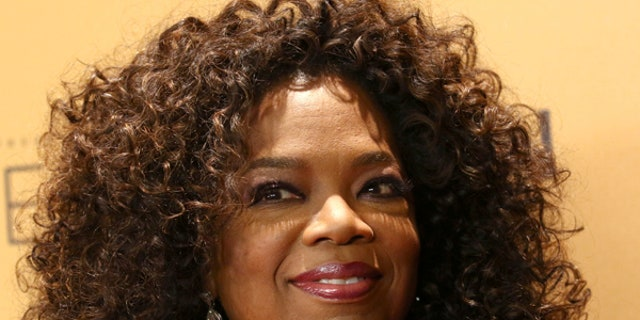 """Oprah Winfrey is seen at the premiere of OWN's documentary series """"Belief"""" at the TimesCenter in New York."""