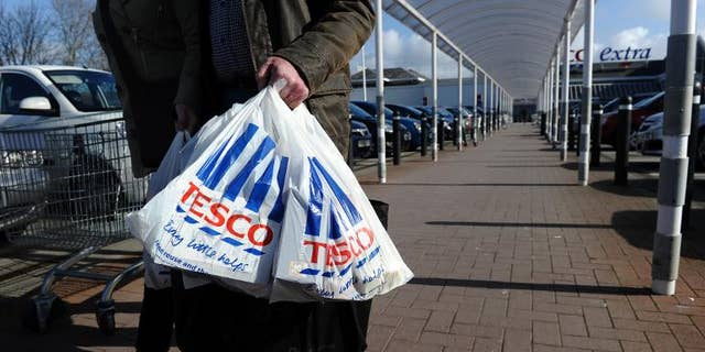 """Tesco said Wednesday it has agreed to form a joint venture with China Resources Enterprise, but added interim net profits dived amid """"challenging"""" trade in Europe"""
