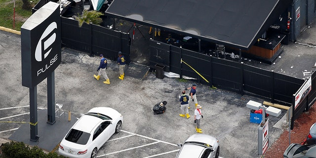 June 15, 2016: Federal Bureau of Investigation officials collect evidence from the parking lot of the Pulse nightclub in the days after the attack.