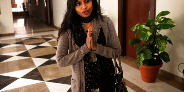 Devyani Khobragade, who served as India's deputy consul general in New York, greets journalists as she leaves Maharastra state house in New Delhi, India, Saturday, Jan. 11, 2014. Khobragade, 39, is accused of exploiting her Indian-born housekeeper and nanny, allegedly having her work more than 100 hours a week for low pay and lying about it on a visa form. Khobragade has maintained her innocence, and Indian officials have described her treatment as barbaric. (AP Photo/Saurabh Das)