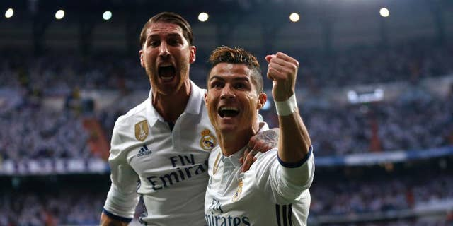 Cristiano Ronaldo celebrates with Real Madrid's Sergio Ramos after scoring the opening goal during the Champions League semifinals first leg soccer match in May.