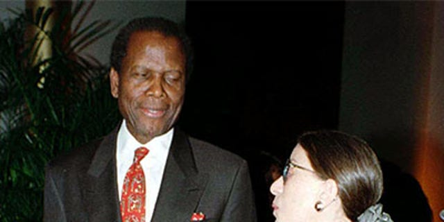"Actor Sidney Poitier (L) chats with Supreme Court Justice Ruth Bader Ginsburg before the premiere of the film, ""Mandela and de-Klerk,"" in which Poitier plays the role of Nelson Mandela, 1997."