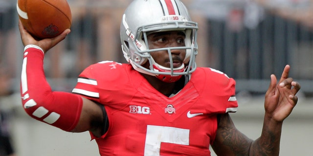 FILE - In this Aug. 31, 2013, file photo, Ohio State quarterback Braxton Miller throws a pass against Buffalo during an NCAA college football game in Columbus, Ohio. Miller is expected to start for the Buckeyes at No. 16 Northwestern this Saturday. (AP Photo/Jay LaPrete, File)
