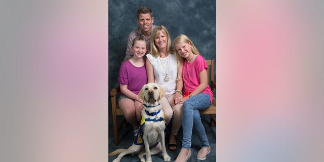 Albie successfully graduated as a service dog in May.