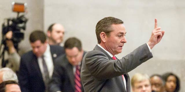 House Republican Caucus Chairman Glen Casada signals to colleagues on the House floor in Nashville, Tenn., Wednesday April 6, 2016, during a debate about a bill to allow counselors to refuse treatment of patients based on personal beliefs. Those opposed to the bill, say the measure casts such a wide net that therapists could virtually turn anyone away. (AP Photo/Erik Schelzig)