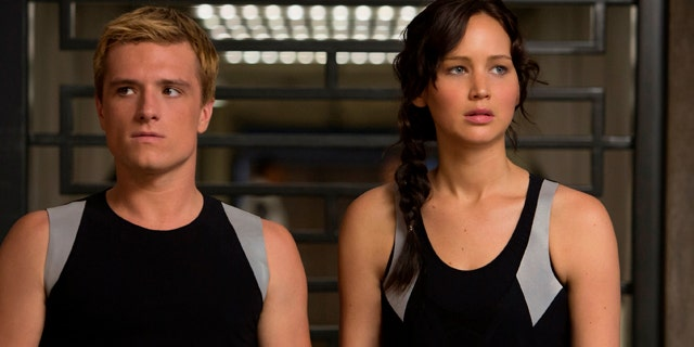 """This image released by Lionsgate shows Josh Hutcherson as Peeta Mellark, left, and Jennifer Lawrence as Katniss Everdeen in a scene from """"The Hunger Games: Catching Fire."""""""