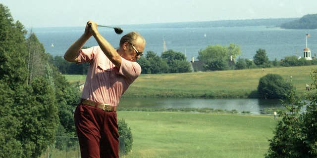 """President Ford plays golf during a working vacation on Mackinac Island in Michigan July 13, 1975. Former President Gerald R. Ford, who declared """"Our long national nightmare is over"""" as he replaced Richard Nixon but may have doomed his own chances of election by pardoning his disgraced predecessor, has died Tuesday Dec. 26, 2006. He was 93. (AP Photo/White House Photograph Courtesy Gerald R. Ford Library)"""