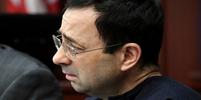A tear falls from Larry Nassar's eye Friday, Jan. 19, 2018, as he is confronted in Circuit Judge Rosemarie Aquilina's courtroom during the fourth day of victim impact statements regarding former sports medicine doctor Larry Nassar, who pled guilty to seven counts of sexual assault in Ingham County, and three in Eaton County.