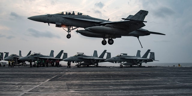 ARABIAN GULF (Nov. 24, 2016) An F/A-18 F Super Hornet assigned to the Fighting Swordsmen of Strike Fighter Squadron (VFA) 32 prepares to make an arrested landing on the flight deck of the aircraft carrier USS Dwight D. Eisenhower (CVN 69) (Ike).