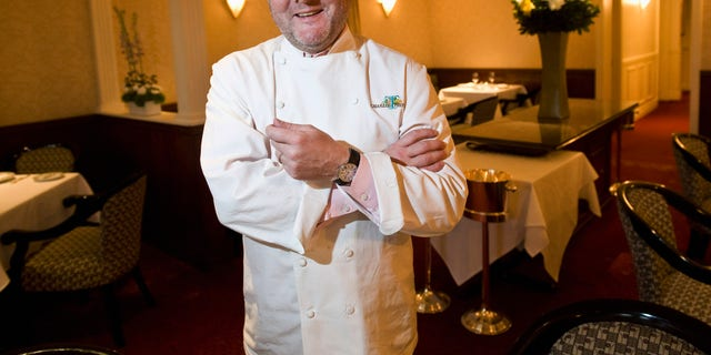 In this Dec. 30, 2011 photo, renowned chef Charlie Trotter poses for a photo in the dining room of his restaurant in Chicago. Trotter died Tuesday, Nov. 5, 2013, a year after closing his namesake Chicago restaurant that was credited with putting his city at the vanguard of the food world and training dozens of the nation's top chefs. He was 54. (AP Photo/Sun-Times Media, Rich Hein)  MANDATORY CREDIT, MAG OUT