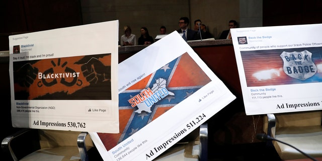 Examples of Facebook pages are seen, as executives appear before the House Intelligence Committee to answer questions related to Russian use of social media to influence U.S. elections, on Capitol Hill in Washington, Nov. 1, 2017.