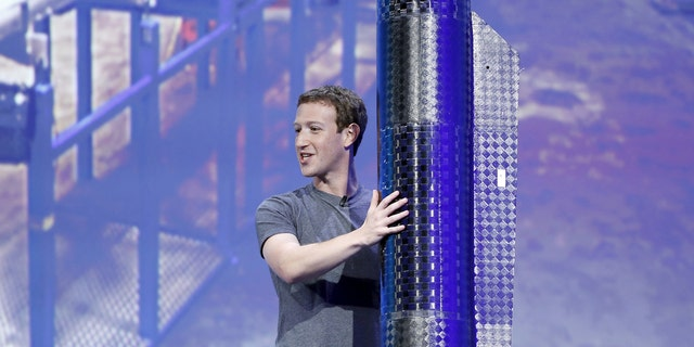 File photo: Facebook CEO Mark Zuckerberg holds a propeller pod of the solar-powered Aquila drone on stage during a keynote at the Facebook F8 conference in San Francisco, California April 12, 2016. (REUTERS/Stephen Lam)