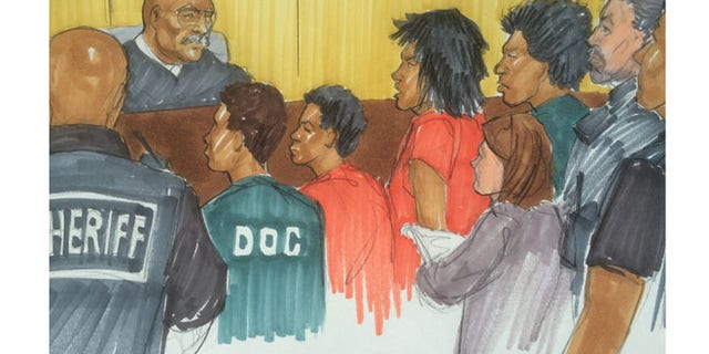The accused in Facebook Torture case are surrounded by sheriffs in a Chicago courtroom.