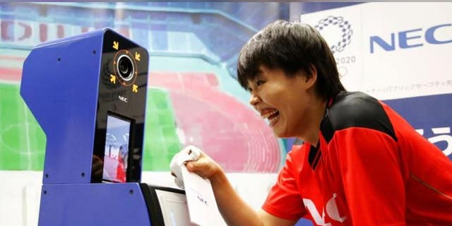 NEC Red Rockets' volleyball player Haruyo Shimamura demonstrates the face recognition system for Tokyo 2020 Olympics and Paralympics, which is developed by NEC corp, in Tokyo, Japan, August 7, 2018.