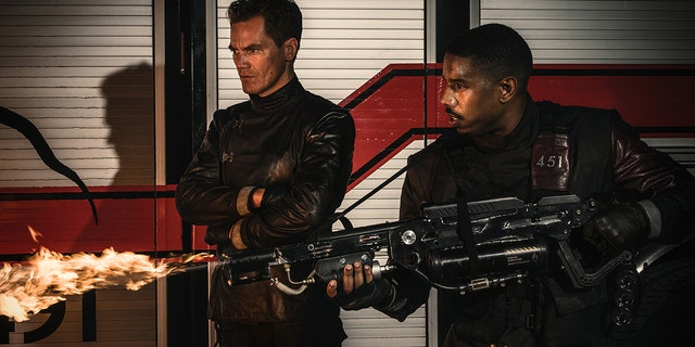 """Michael Shannon (left) and Michael B. Jordan in HBO's """"Fahrenheit 451."""" The film is based off of the Ray Bradbury novel of the same name which is about a future American society where books are outlawed and burned."""