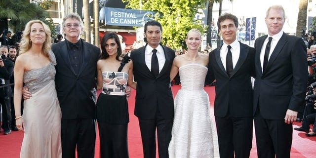 """May 20: Valerie Plame and Joe Wilson, left, join Liraz Charhi, Khaled Nabawy, Naomi Watts, Director Doug Liman and Noah Emmerich, at the screening of the film """"Fair Game,"""" at the 63rd Cannes Film Festival in France."""