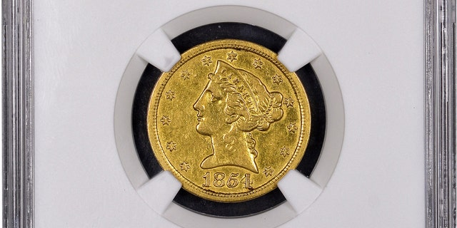 "Mistakenly believed by its anonymous New England owner to be a fake, this historic gold coin now has been authenticated as ""the discovery of a lifetime"" by Numismatic Guaranty Corporation (www.NGCcoin.com) in Sarasota, Florida as only the fourth known surviving example of a $5 denomination coin struck at the San Francisco Mint during the California Gold Rush in 1854.  It is worth millions of dollars, according to NGC. Photos courtesy of Numismatic Guaranty Corporation www.NGCcoin.com. (PRNewsfoto/Numismatic Guaranty Corporation)"
