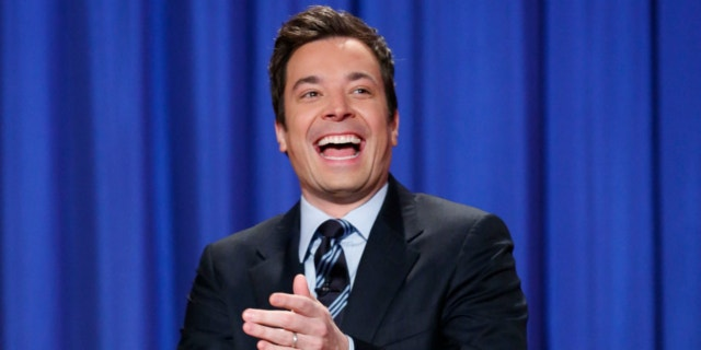 """FILE: April 4, 2013: This photo released by NBC shows Jimmy Fallon, who made his debut as host of his new show, """"The Tonight Show with Jimmy Fallon,"""" on Feb. 17."""