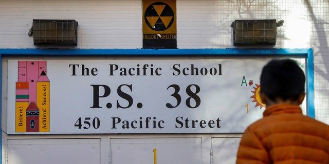 A fallout shelter sign over the entrance to P.S. 38 in Brooklyn.