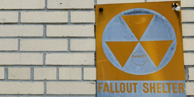 A yellow nuclear fallout shelter sign is seen hung on a building in Brooklyn earlier this month.