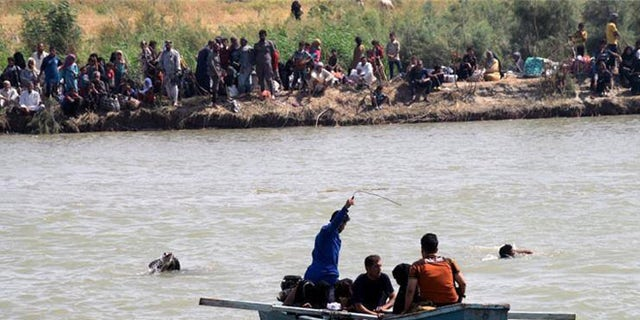 Several residents have died fleeing Fallujah on boats and rafts, in a dangerous crossing of the Euphrates.