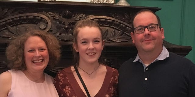 Andrea Rashbaum with her daughter, Maddie, and her husband.