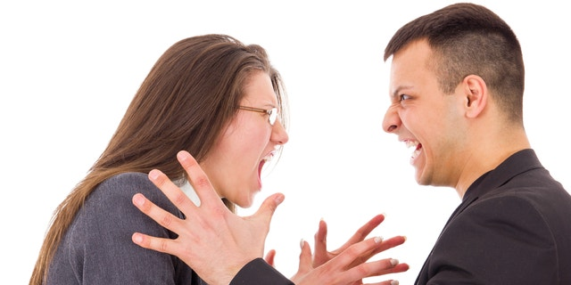 young angry couple fighting wanting to strange each other