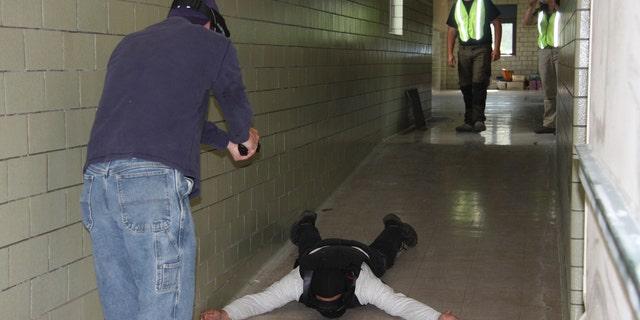 Teachers practice for an active shooter scenario in an Ohio school.