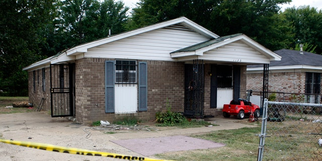 The outside of a Memphis home where a fire killed 11 people. Metal bars were placed over most windows of the house.