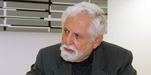 Oct. 20, 2009: Carl Djerassi talks to Austrian Chancellor Werner Faymann, not seen, at the federal chancellery in Vienna, Austria.