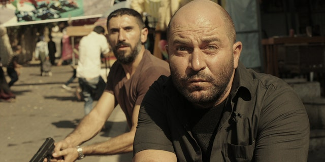 "Lior Raz (right) stars as Doron Kavillio in ""Fauda."""