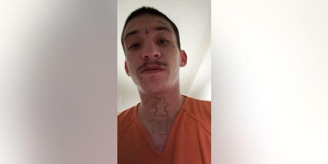 Joseph Chavez, 22, records a Facebook Live video inside his jail pod in Jefferson County, Colo., on Thursday.