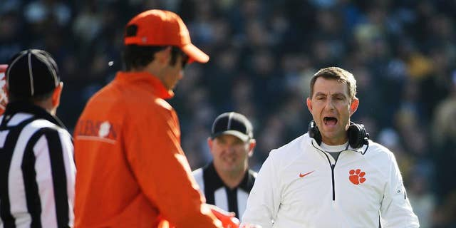 Clemson head coach Dabo Swinney argues a call with an official in the fourth quarter of an NCAA college football game against Georgia Tech, Saturday, Nov. 15, 2014, in Atlanta. Georgia Tech won 28-6. (AP Photo/David Goldman)