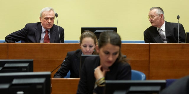 Former state security chief Jovica Stanisic, left, and former paramilitary leader Franko Simatovic, right, await their judgment at the Yugoslav war crimes tribunal (ICTY) in The Hague, Netherlands, Thursday May 30, 2013. The ICTY is set to deliver verdicts in the trial of two senior Serb security officials accused of supporting rebels who murdered Muslims and Croats in Bosnia's 1992-95 war. (AP Photo/Martijn Beekman, Pool)
