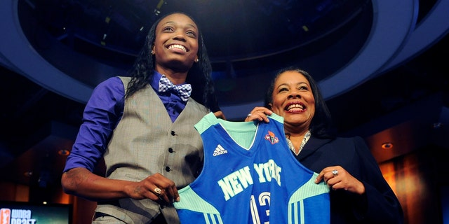Oklahoma State's Toni Young holds up a New York Liberty jersey with WNBA president Laurel J. Richie after New York selected Young as the No. 7 pick in the WNBA basketball draft in Bristol, Conn., Monday, April 15, 2013. (AP Photo/Jessica Hill)