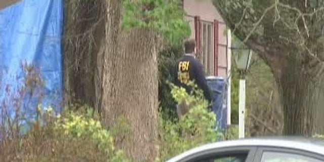 FBI agents search Robert Gentile's home on May 2, 2016.