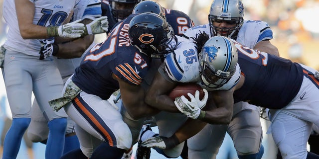 Detroit Lions running back Joique Bell (35) is tackled by Chicago Bears defenders during the second half of an NFL football game, Sunday, Nov. 10, 2013, in Chicago. The Lions won 21-19. (AP Photo/Nam Y. Huh)