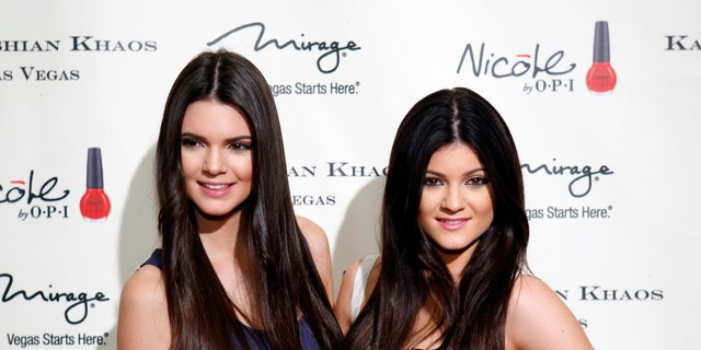 Television personalities Kendall Jenner (L) and younger sister Kylie Jenner arrive at the grand opening of the Kardashian Khaos store at the Mirage Hotel and Casino in Las Vegas, Nevada December 15, 2011.