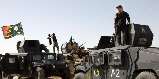 Oct. 14, 2016: Iraqi special forces soldiers deployed for an offensive to retake Mosul from Islamic State militants prepare to move out from a camp near Khazer, Iraq.