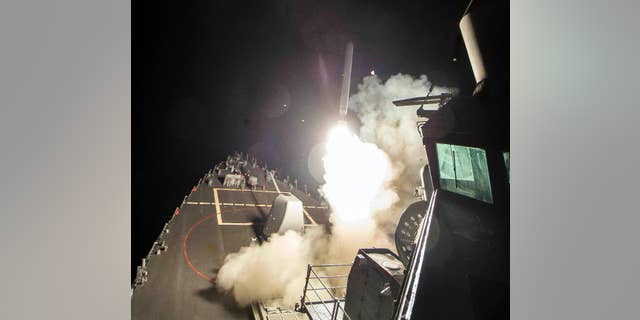 the USS Ross fires a tomahawk missile bound for a Syrian air base.