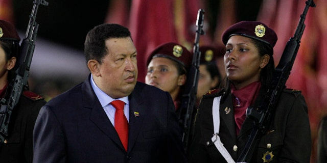 Venezuela's President Hugo Chavez attends a military ceremony marking the 75th anniversary of the creation of the Bolivarian National Guard at Fuerte Tiuna military base in Caracas, Venezuela, Friday, Aug. 10, 2012. (AP Photo/Ariana Cubillos)