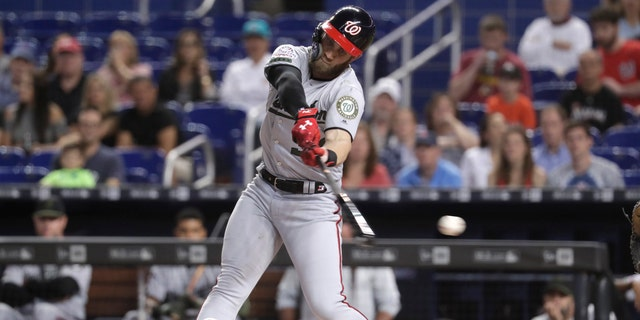 Washington Nationals' Bryce Harper strikes out swinging during the first inning of a baseball game against the Miami Marlins, Saturday, May 26, 2018, in Miami.