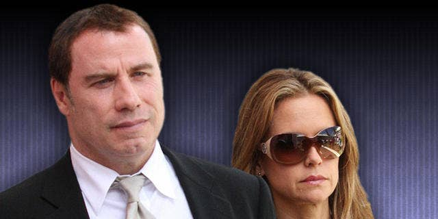 Actor John Travolta and wife Kelly Preston in 2009.