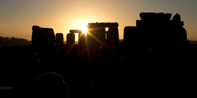 File photo - Dec. 21, 2012: The sun passes through the stones after rising at the ancient stone circle of Stonehenge, in southern England, as access to the site is given to druids, New Age followers and members of the public on the annual Winter Solstice.