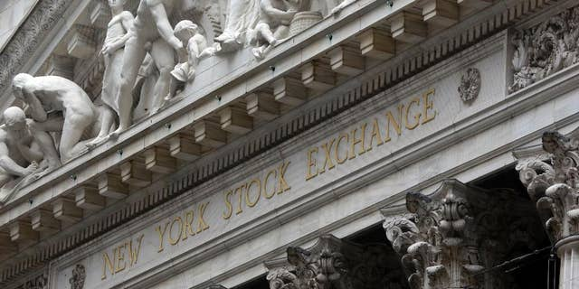 FILE - This Oct. 2, 2014 file photo shows the facade of the New York Stock Exchange, in New York. U.S. stocks opened higher Wednesday, April 8, 2015, as investors waited for the release of minutes from the Federal Reserve's latest meeting. Investors were also waiting for companies to start reporting their first-quarter earnings. Alcoa, a metals company, will be one of the first major companies to report earnings after the close of the market. (AP Photo/Richard Drew, File)